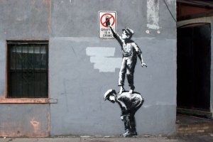 banksy-graffiti-is-a-crime-street-art-in-new-yorks-chinatown-01